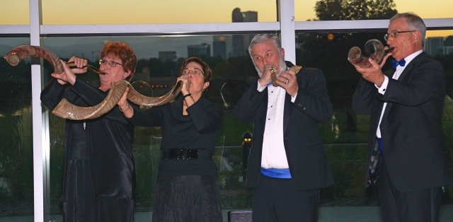Singers blowing shofars at Denver Museum of Nature and Science. Left to right: Kim Harris, Judy Megibow, Seth Ward, Jeff Bain