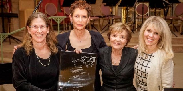 Presentation of plaque to Estelle Nadel. From left to right: Carol Kozak Ward, Leah Peer, Estelle Nadel, Annette Tillman0Dick