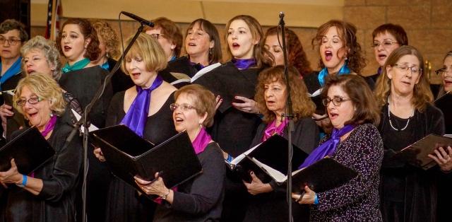 Women of Kol Nashim singing. Raisins and Almonds 2019