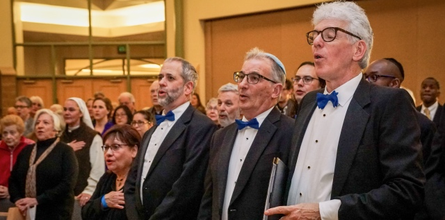 three singers in tuxedo during the Israeli national anthem